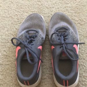 Nike running shoes pink and grey